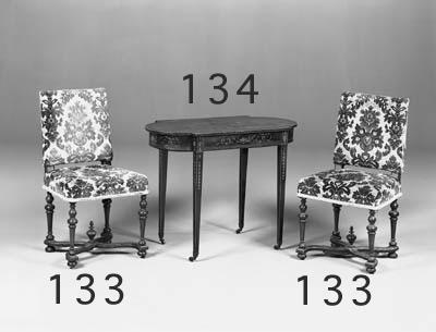 A set of six walnut and uphols