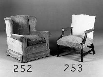 A pair of Howard easy armchair