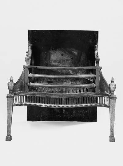 A brass and iron firegrate
