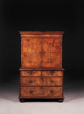A walnut cabinet-on-stand, 18t
