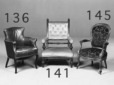 A pair of Edwardian upholstered armchairs