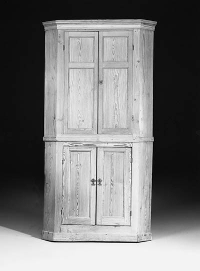 A pine corner cupboard, 18th century