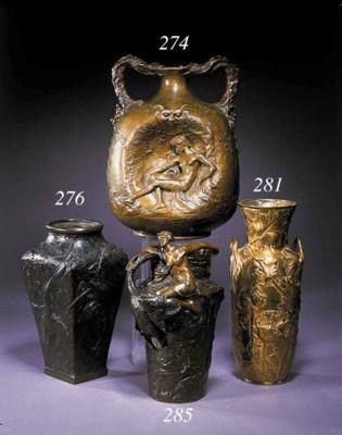 A patinated bronze jug