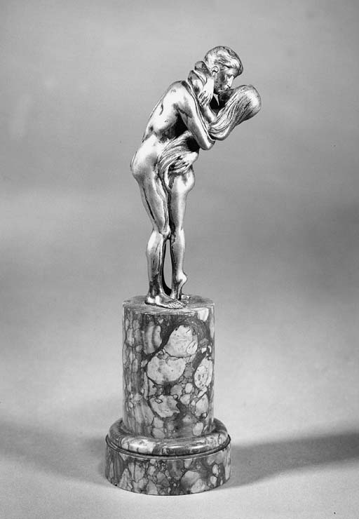 A patinated bronze figure grou