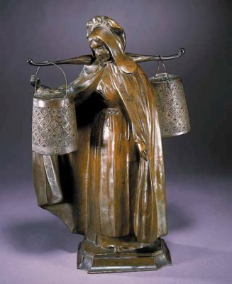 A patinated bronze figural lam