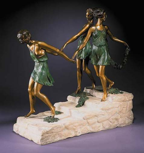 A gilt and green patinated fig