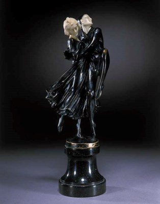 A black patinted bronze and iv