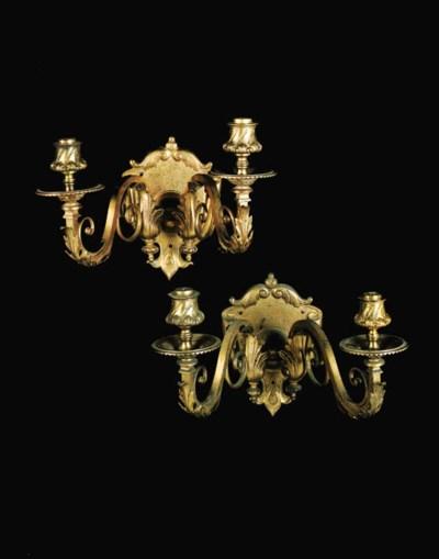 A set of eight gilt brass twin