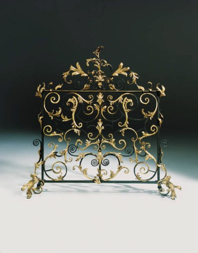 A French wrought iron fire scr