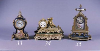 A FRENCH GOLD-PAINTED SPELTER