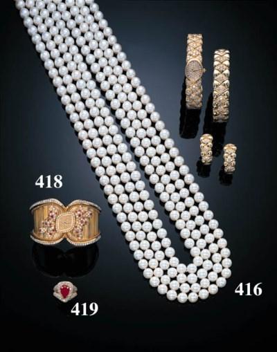 A LADY'S RUBY, DIAMOND AND 18K