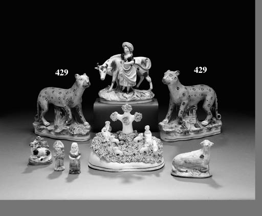 A PAIR OF STAFFORDSHIRE MODELS OF LEOPARDS
