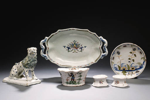 A FRENCH FAIENCE SHAPED-OVAL TWO-HANDLED DISH
