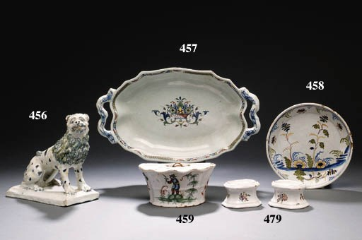 A FRENCH FAIENCE D-SHAPED BOUQ
