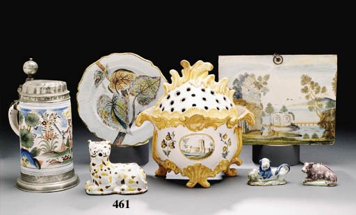A FRENCH FAIENCE MODEL OF A RE