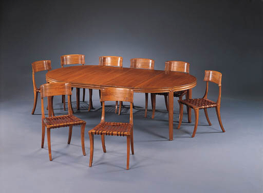 A FRUITWOOD DINING TABLE AND EIGHT CHAIRS T H ROBSJOHN
