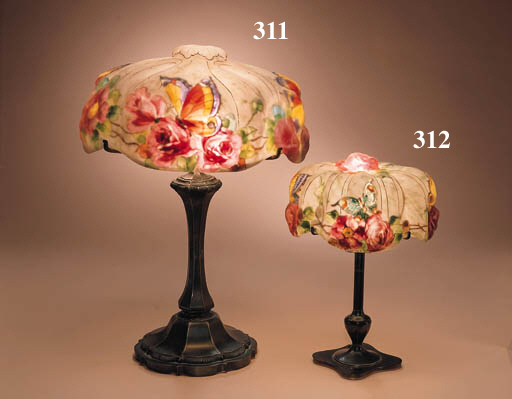 A 'BUTTERFLY AND ROSES' REVERSE-PAINTED GLASS AND PATINATED-METAL BOUDOIR LAMP