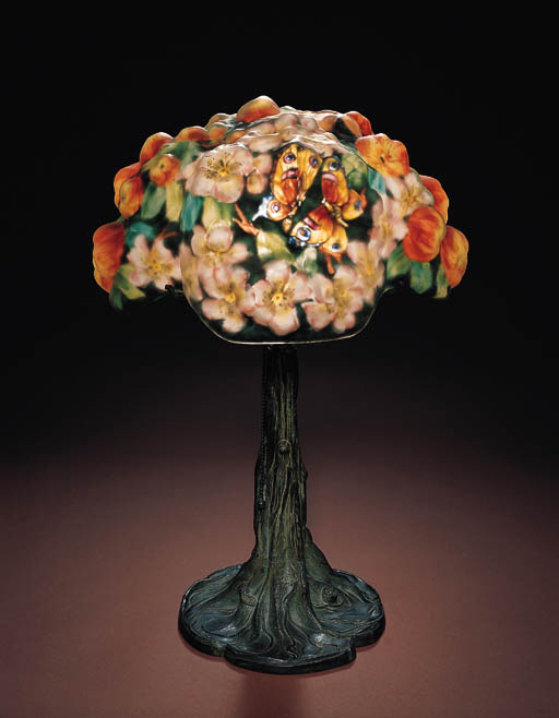 A FINE 'APPLE TREE' REVERSE-PAINTED GLASS AND PATINATED-METAL TABLE LAMP