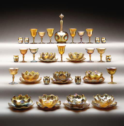 A SET OF TWELVE FAVRILE GLASS FINGER BOWLS AND UNDERDISHES