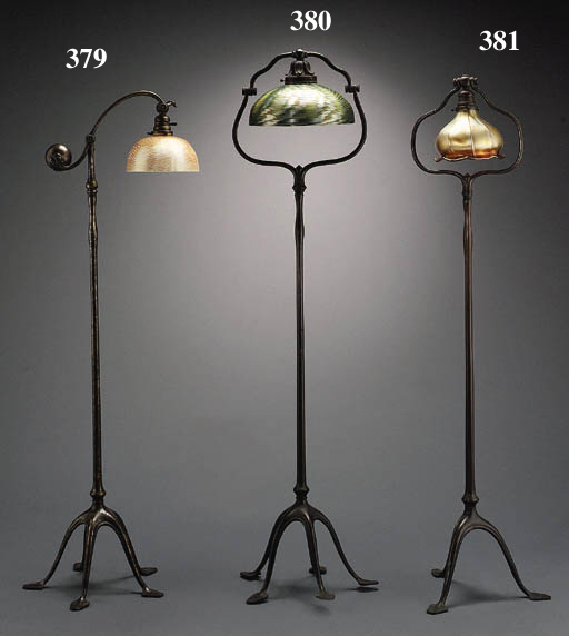 A FAVRILE GLASS AND BRONZE FLOOR LAMP