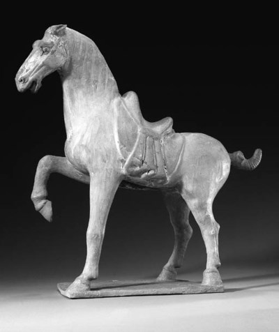 A LARGE PAINTED POTTERY HORSE