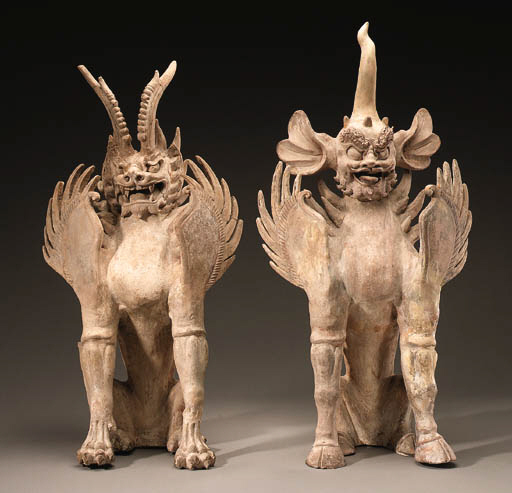 A PAIR OF BUFF POTTERY EARTH S