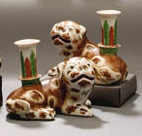 A PAIR OF PUG DOG CANDLEHOLDER