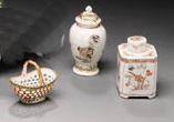 TWO IRON-RED, GILT AND ENAMEL TEA CADDIES AND COVERS AND A SMALL BASKET