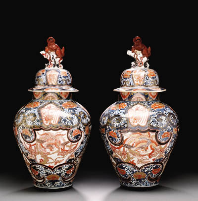 A LARGE PAIR OF JAPANESE ARITA VASES AND COVERS