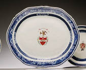A BLUE AND WHITE ARMORIAL OVAL