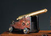 A REGENCY BRASS AND MAHOGANY MODEL OF A CANNON