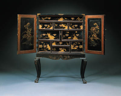 A JAPANESE BRASS-MOUNTED BLACK AND GILT LACQUER CABINET ON ENGLISH JAPANNED STAND
