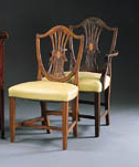 A SET OF SIXTEEN GEORGE III STYLE MAHOGANY DINING-CHAIRS