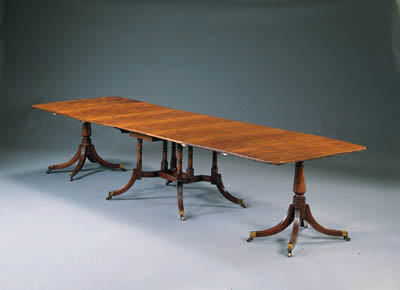 A REGENCY STYLE MAHOGANY THREE