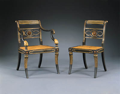 A SET OF EIGHT REGENCY EBONIZED AND PARCEL-GILT DINING-CHAIRS