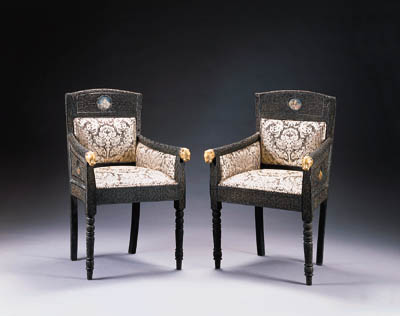 A SET OF SIX ANGLO-INDIAN BRASS-MOUNTED AND GOUACHE-INSET EBONIZED ARMCHAIRS