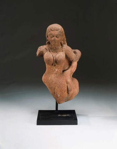 A red sandstone figure of a go