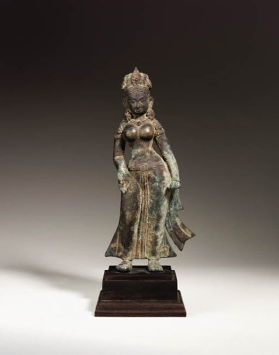An early and rare bronze figur