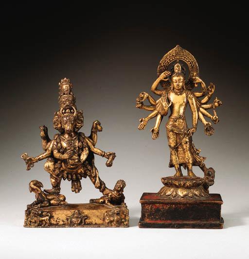 A gilt bronze figure of Amogha