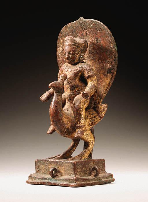 A gilt bronze figure of Kumara