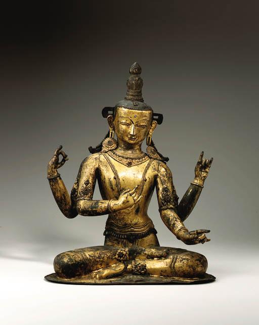 A gilt copper repouss figure o