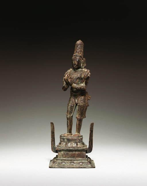 A bronze figure of saint Cande