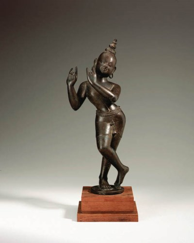 A bronze figure of Krishna