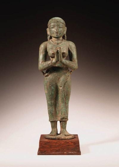 A bronze figure of a female de