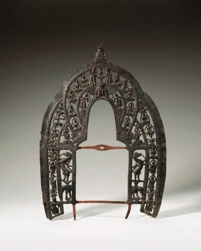 A rare bronze throne back