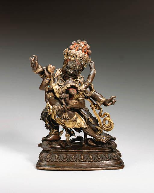 A parcel gilt bronze figure of