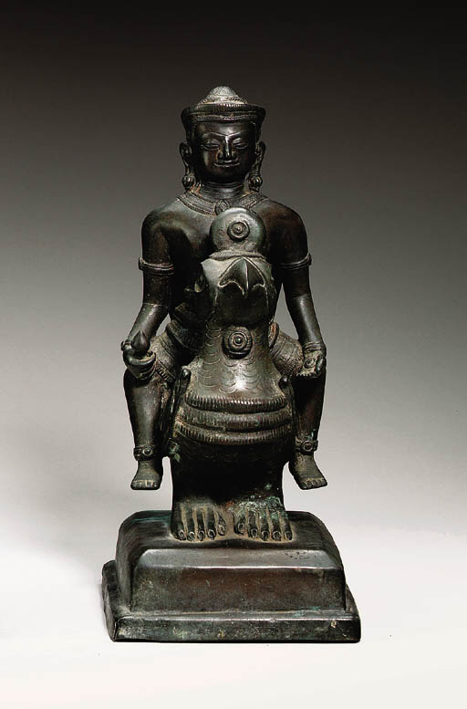 A bronze group of a deity on a