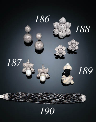 A PAIR OF CULTURED PEARL AND DIAMOND FLOWER EAR CLIPS