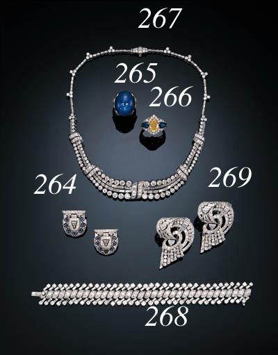 A FINE ART DECO FANCY VIVID YELLOW DIAMOND, SAPPHIRE AND NEAR COLORLESS DIAMOND RING