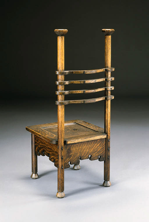 AN OAK HALL CHAIR | CHARLES ROHLFS, 1901 | Christie's